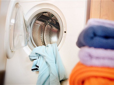 Washing machine with yellow towel